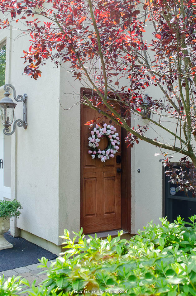 cherry stained side entrance garage door with Schlage Encode Deadbolt