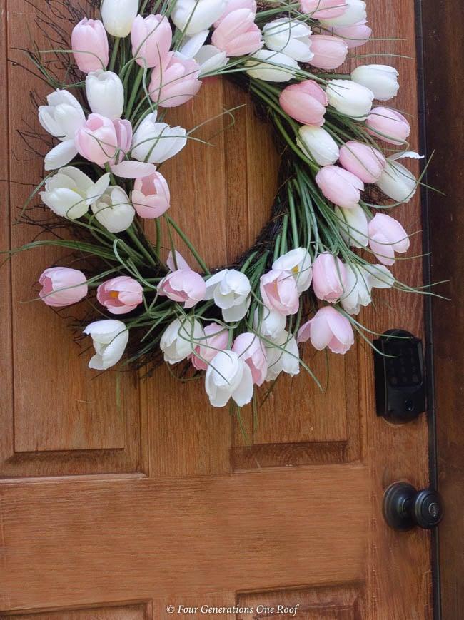 tulip wreath, cherry stain garage door, Side Entrance Garage Door Makeover with Schlage