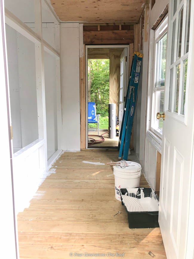 white paint walk in chicken coop, partition wall for alley way