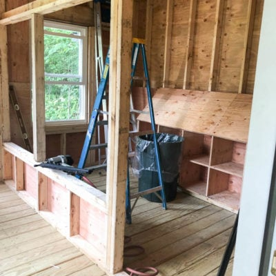 Painting White Nesting Boxes in Walk In Chicken Coop