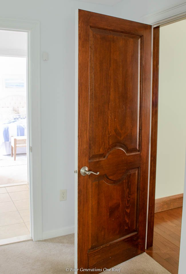 Two toned interior bedroom door with stain and white paint