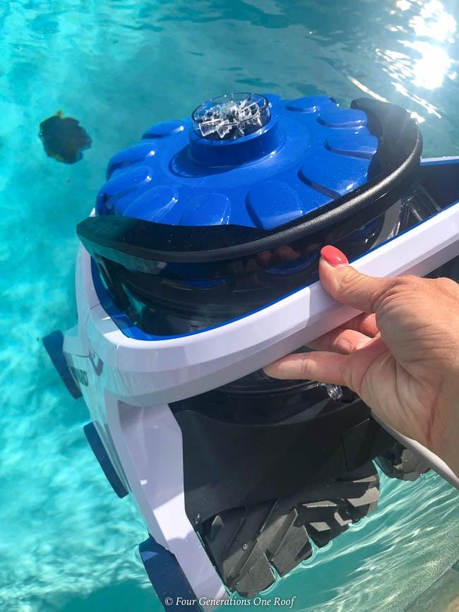 woman putting Hayward AquaVac 6 Series robotic pool cleaner in the pool
