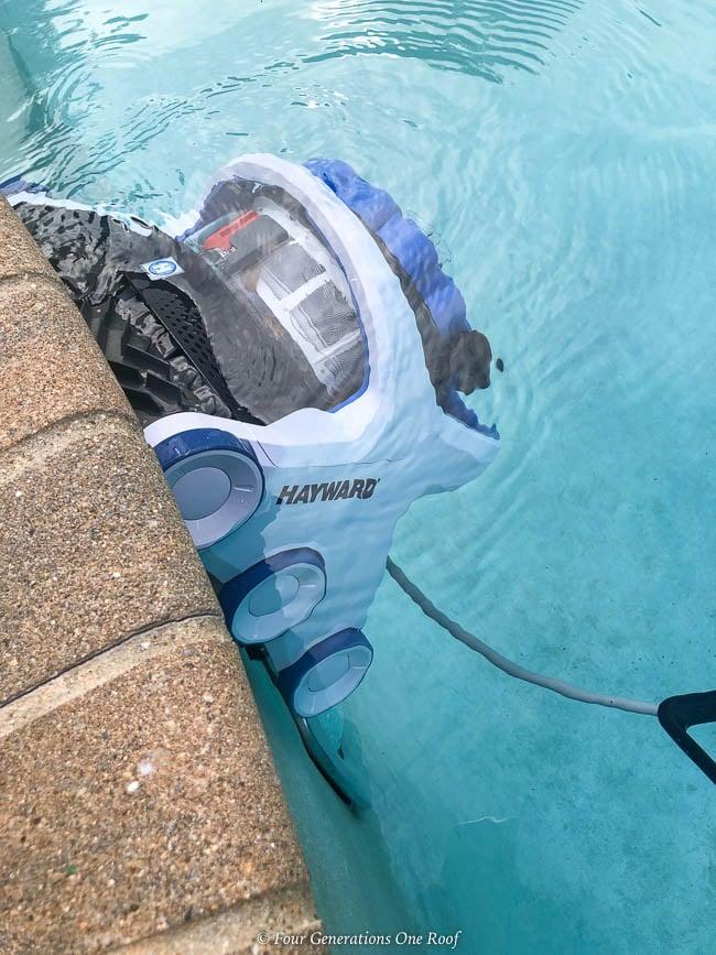 Best pool cleaning robot - Hayward AquaVac 6 Series robotic pool cleaner climbing pool wall