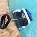 Hayward AquaVac 6 Series robotic pool cleaner filter full of leaves