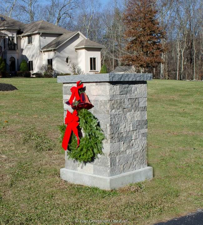 Airstone Spring Creek Driveway Entrance Column with Christmas wreath, red bow, red bells