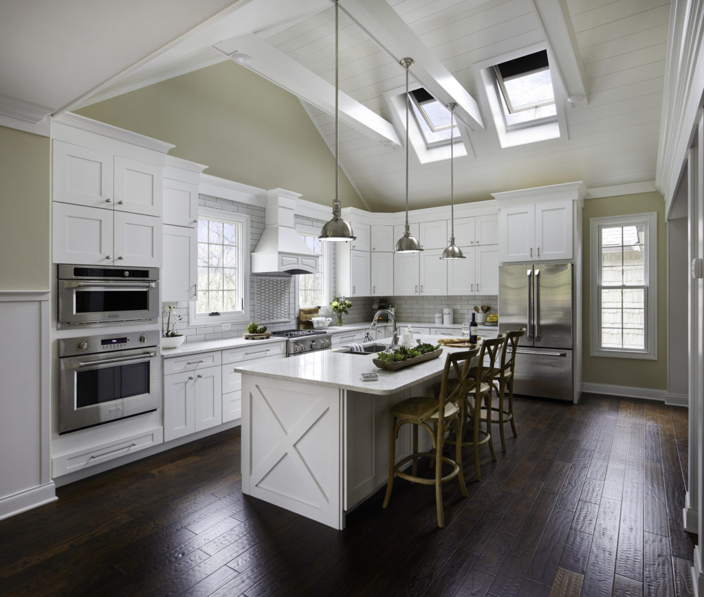 white kitchen with VELUX skylights dark wood floors