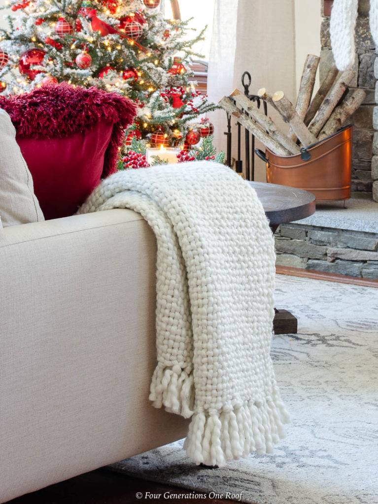 white cable knit throw on a white sectional