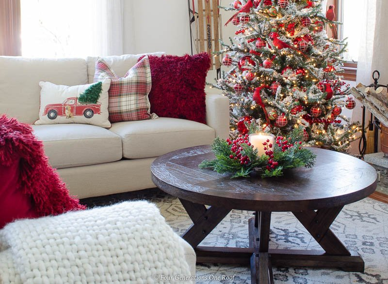white sectional sofa, red throw pillow, plaid throw pillow, red vintage truck christmas throw pillow, brown round coffee table, black and white rug, red flocked Christmas tree
