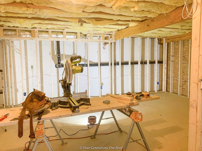 2x4 framing against a cement wall