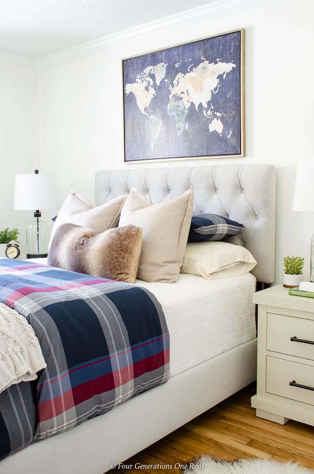 Tiny White Guest Bedroom, Adjustable Base Bed, world map wall art, plaid duvet, glass jar lamp, gray velour headboard, white night table