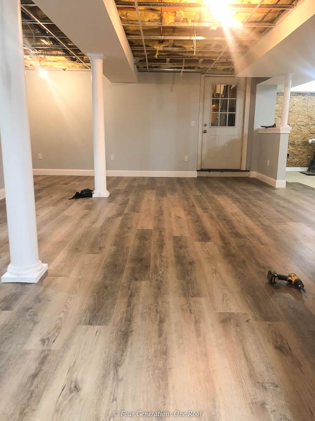 Harvest Oak Rigid Core Vinyl Flooring, Sherwin Williams Lullabye paint and white lally columns