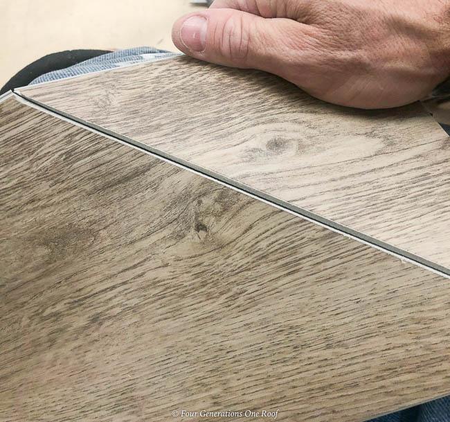 utility knife cutting Harvest Oak rigid core vinyl flooring