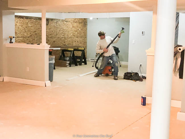 Basement remodel Jim playing air guitar with a shop vac