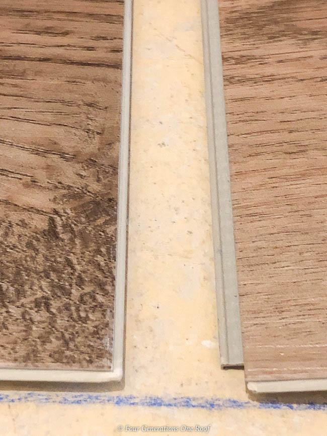 Click Together Installing Rigid Core Vinyl Flooring over Cement in Basement