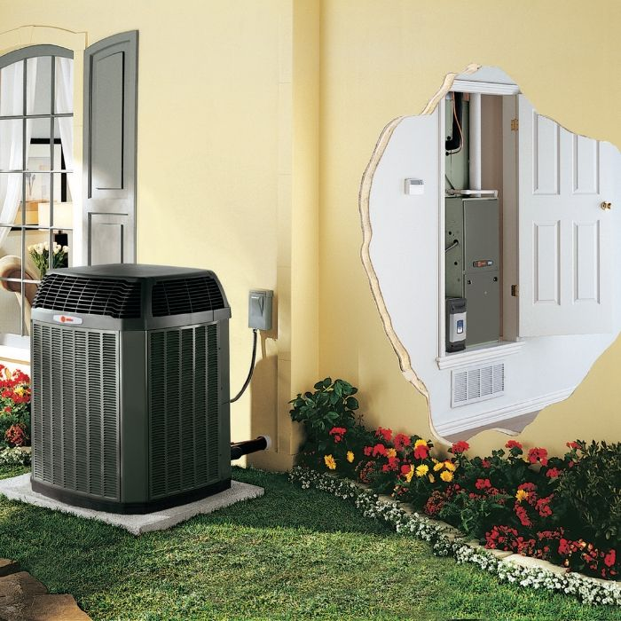 trane ac unit outdoors with inside filter system