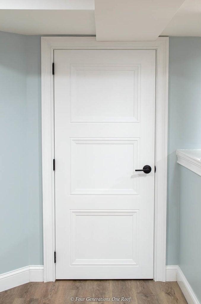 White Masonite Livingston interior door with black hardware