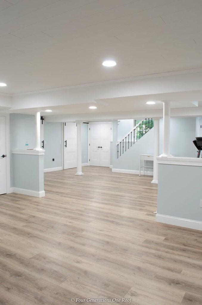 harvest oak color Select Flooring vinyl plank flooring, masonite livingston white interior doors, basement columns, Armstrong ceiling planks