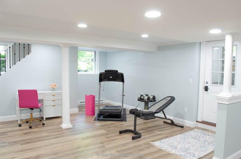 harvest oak vinyl plank flooring, basement gym, lullabye blue wall, Armstrong white ceiling planks