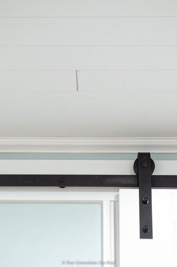 Armstrong Ceilings WoodHaven Planks in a white textured woven finish , black barn door sliding track