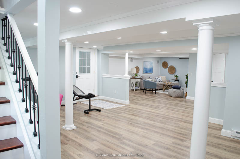 basement makeover with white ceiling and vinyl floor planks