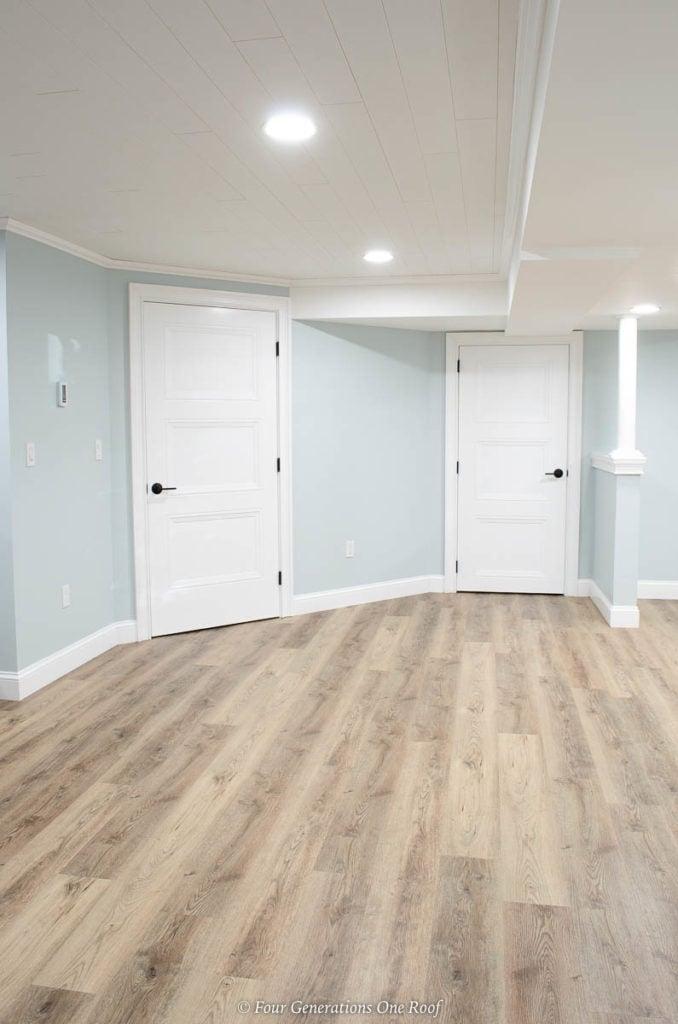 Masonite Livingston interior barn sliding door, harvest oak vinyl plank flooring, Armstrong ceiling planks