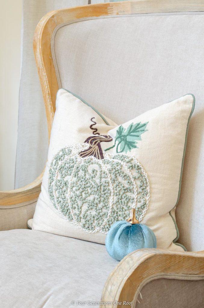 white and blue Pumpkin throw pillow with beaded pumpkin design