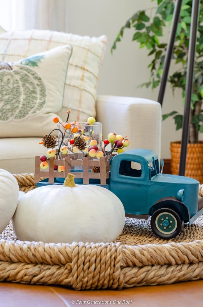 Blue Fall Antique Truck with white pumpkin coffee table decor