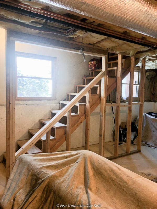 opening up a basement staircase before balusters are installed