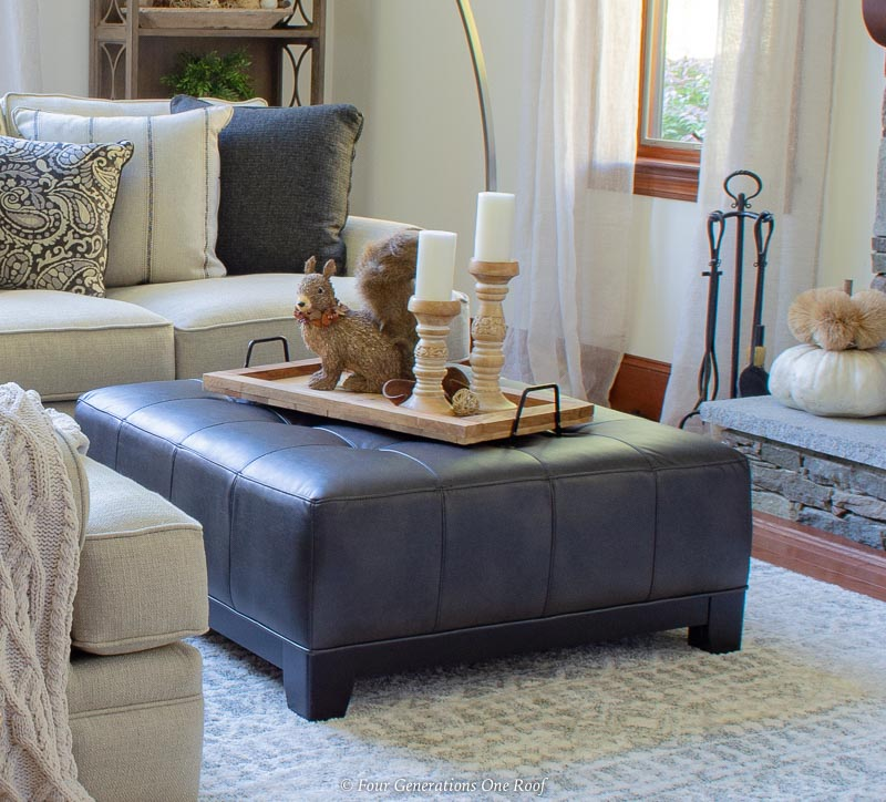black leather ottoman, white sectional, wood tray home decor