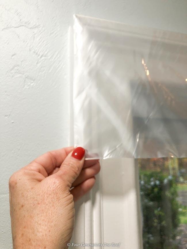 Duck window shrink film on white trim window