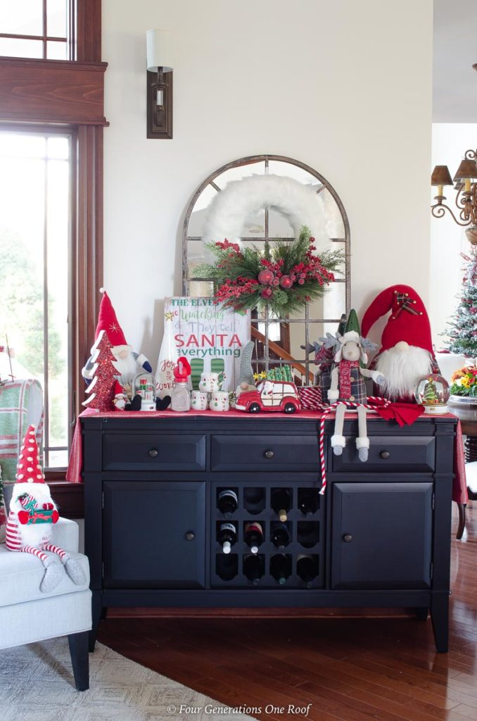 black wine cabinet, christmas wreath, hot chocolate goodies, christmas gnomes