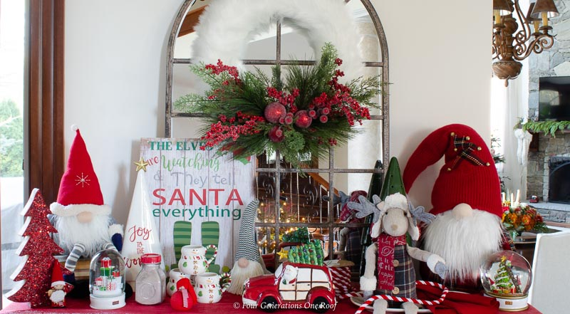 christmas station gnomes, arched mirror, fluffy white wreath, santa sign, red vintage truck, hot chocolate
