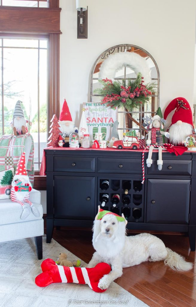 white goldendoodle, black wine cabinet, christmas wreath, hot chocolate goodies, christmas gnomes