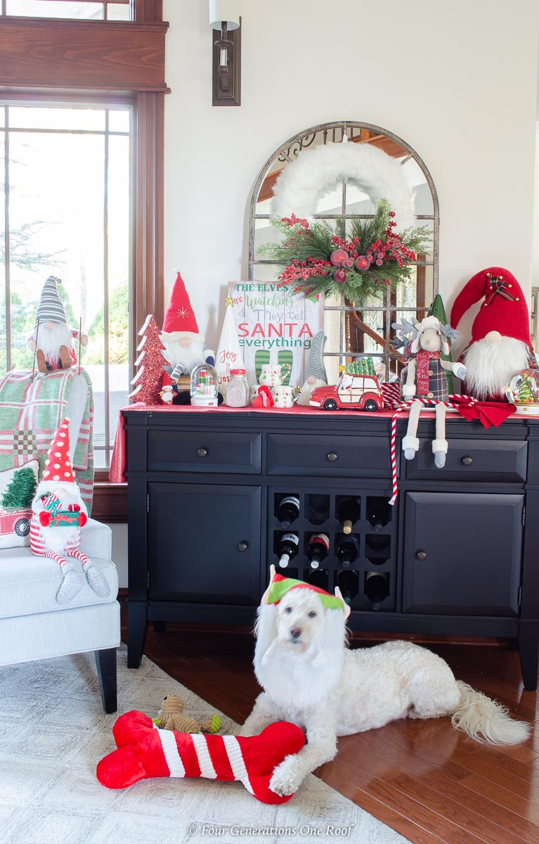 white goldendoodle, black wine cabinet, DIY christmas station wreath, hot chocolate goodies, christmas gnomes