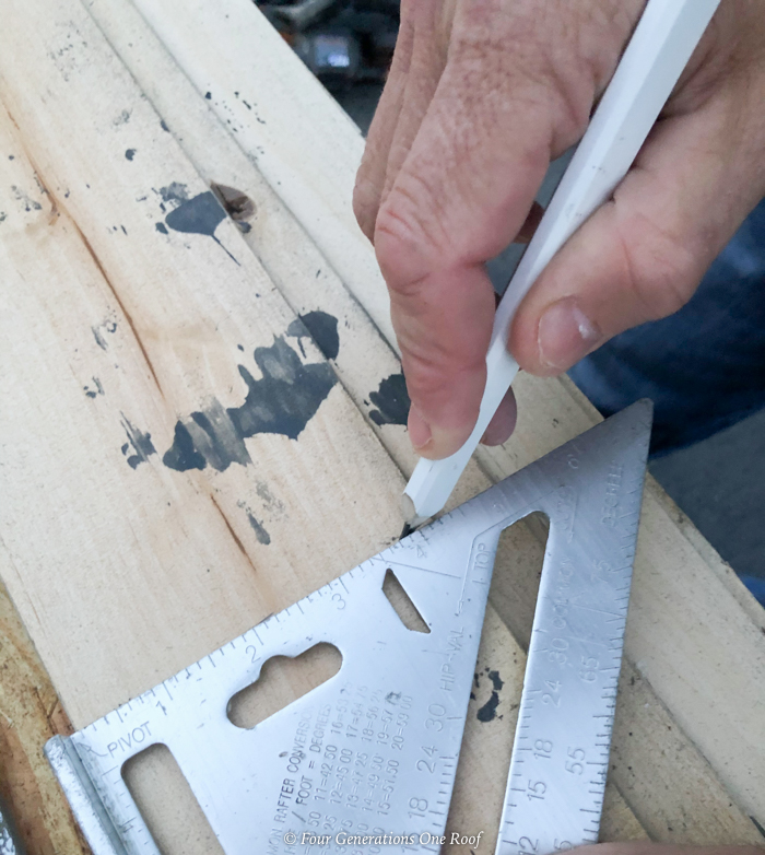 speed square to draw a straight line on wood plank