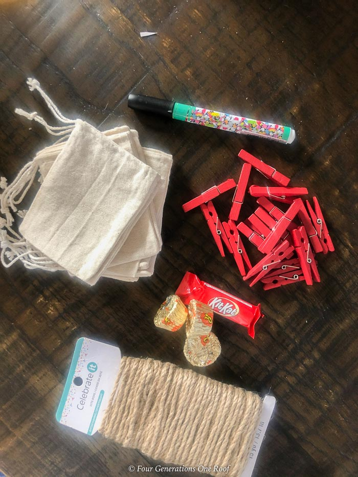 burlap satchels, black fabric pen, burlap twine, red clothespins, kit kats