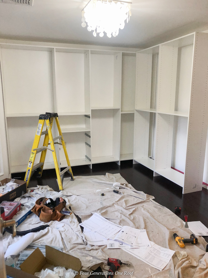 bedroom turned walk in closet - white closet system