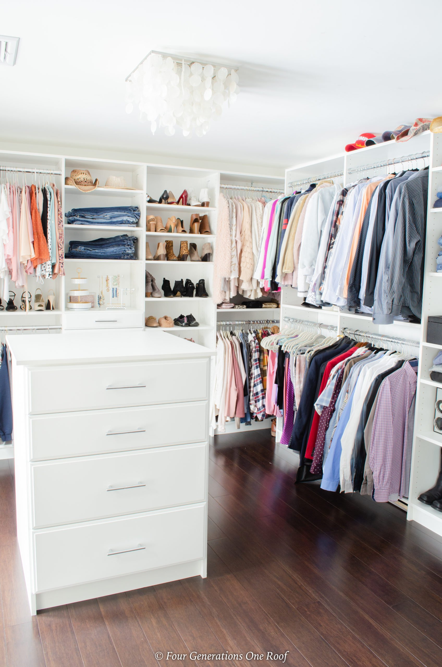 spare bedroom turned white walk in closet system, closet island , caprizi light