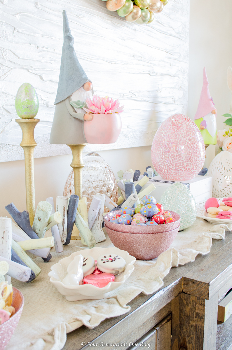 Easter gnomes, gold candlesticks, candy bowls, glass easter eggs, ruffled runner, Easter candy