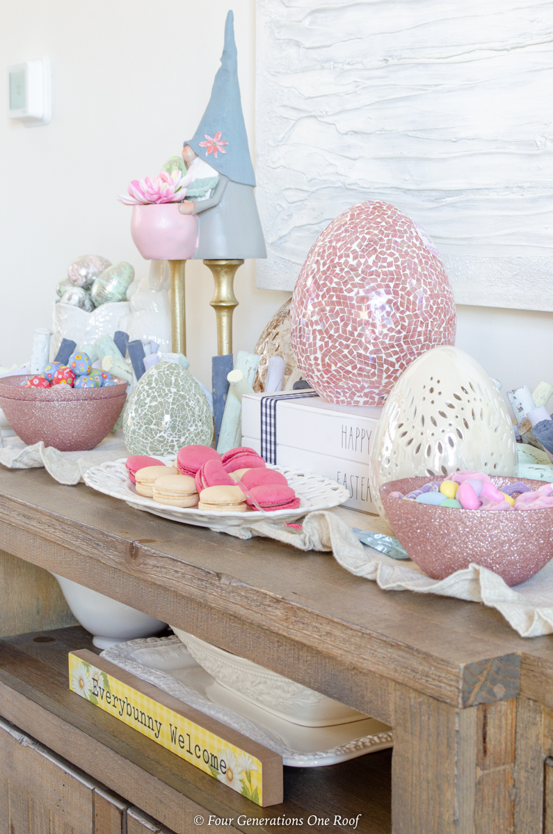 Easter Dining Room Decorating Ideas with bunny station - pink glass Easter eggs, white ceramic easter eggs, gold candlesticks, Easter gnomes, Easter candy