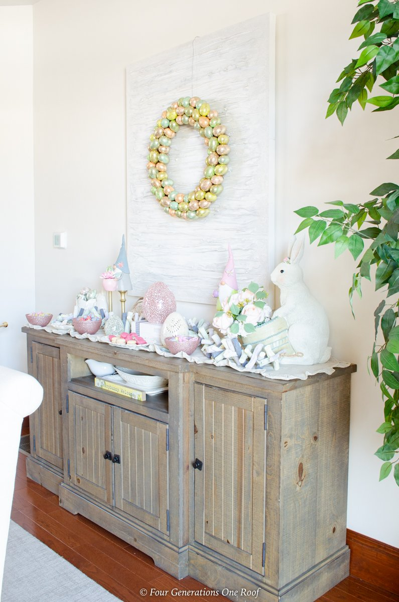 Easter Dining Room Decorating Ideas with bunny station -Glass Easter Eggs, ceramic bunny, Easter tulips, hanging Easter egg wreath, Easter candy, buffet table