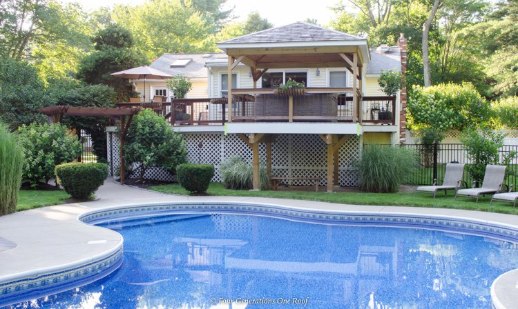 inground pool with patio and hot tub deck