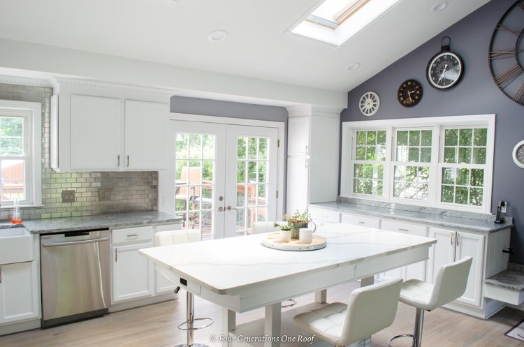 white and gray split level open kitchen with island