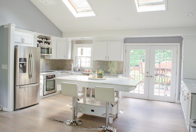 split level house with kitchen vaulted ceiling and skylights