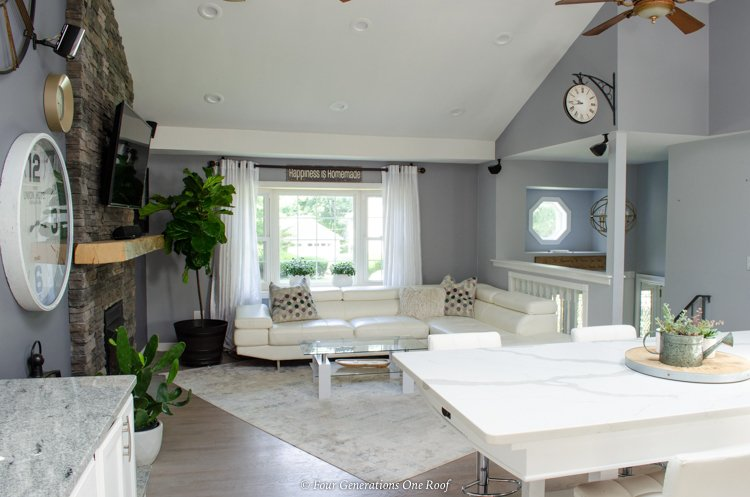 split level house with open kitchen + living room + open entryway