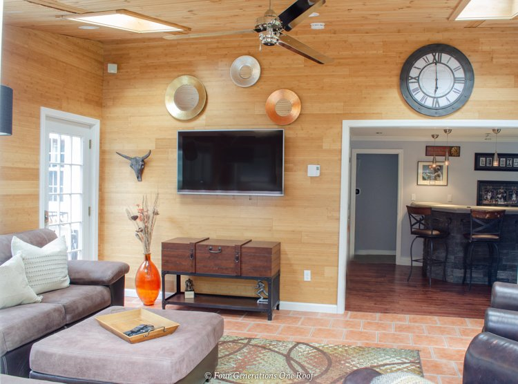 split level house addition sunroom + bar with wood plank walls