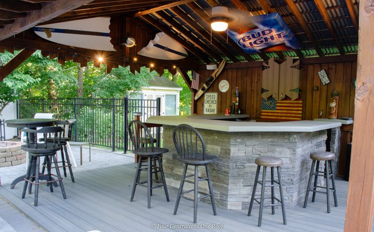 Jimmy Buffet style pool cabana with red wood beams and metal roof