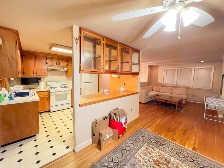 1970s split level house kitchen wall with dining room and living room