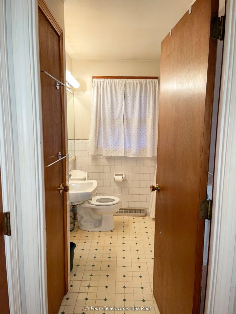 1970s small narrow bathroom with flower curtain