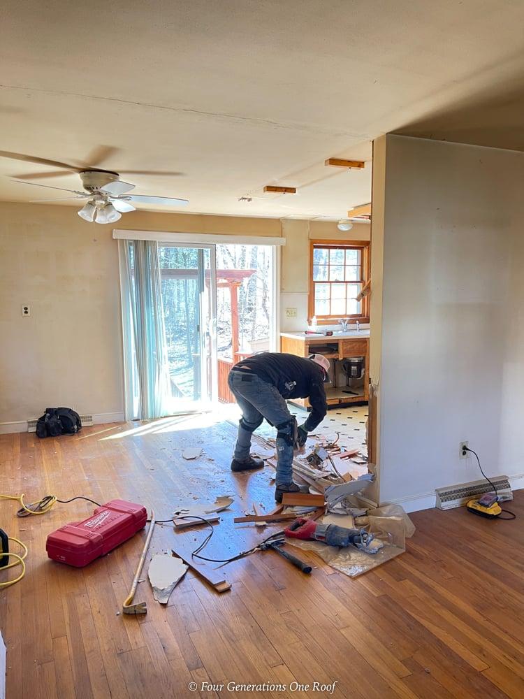 split level dining room, kitchen and living room demo with hardwood floor